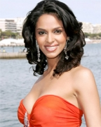 Mallika plays with python at Cannes