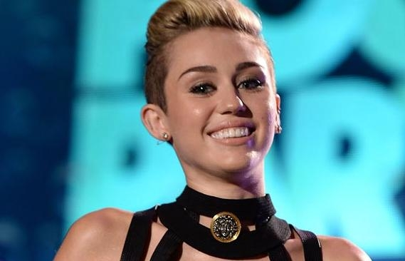 Miley Cyrus gets Rolling Stone tattoo
