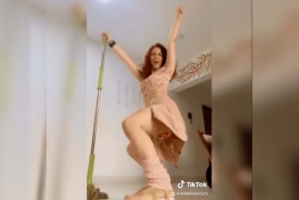 Elli AvrRam ends up dancing with the mop instead cleaning